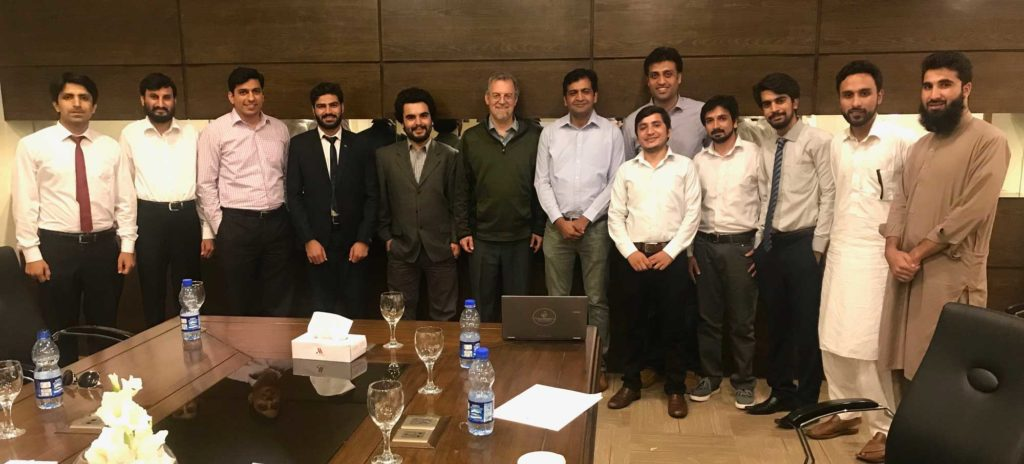 Clark Miller meeting with the research team working on improving the social value of energy in KP villages.