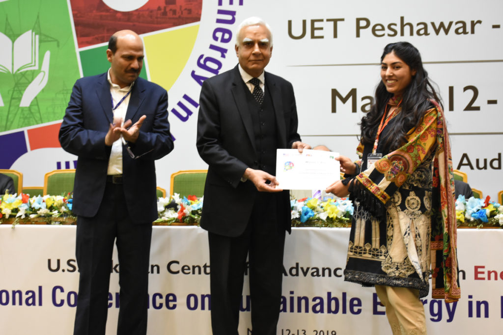 USPCAS-E master's student Leena Aftab, right, received first prize in the student poster competition.