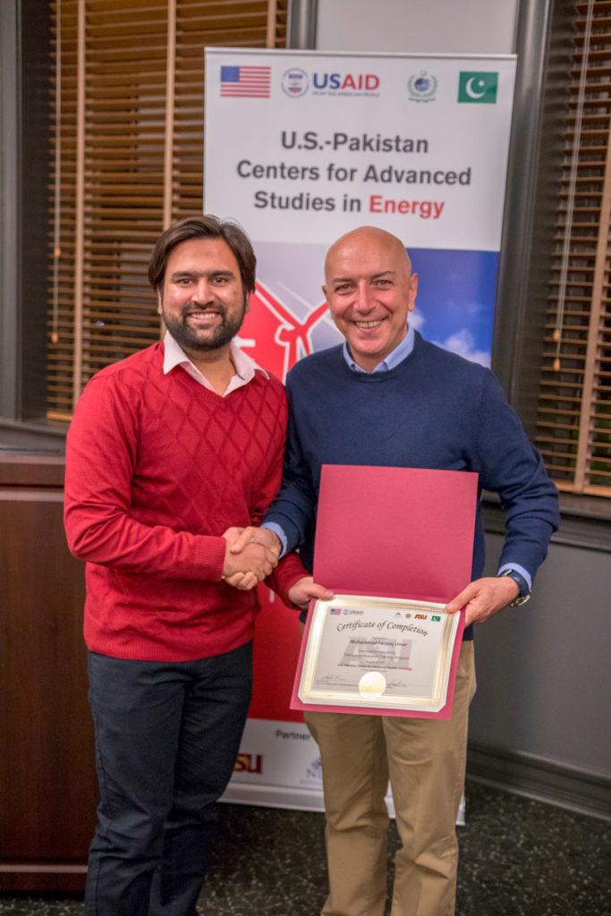 Farooq Umar is congratulated by ASU Professor Bertan Bakkaloglu at the completion of his exchange program at ASU