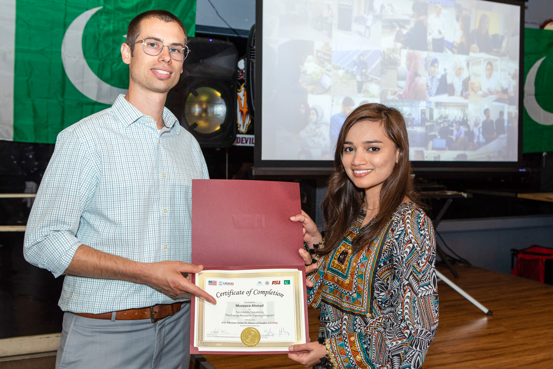 USPCAS-E Scholar Muneeza Ahmad receives completion certificate from Dr. Zachary Holman at ASU