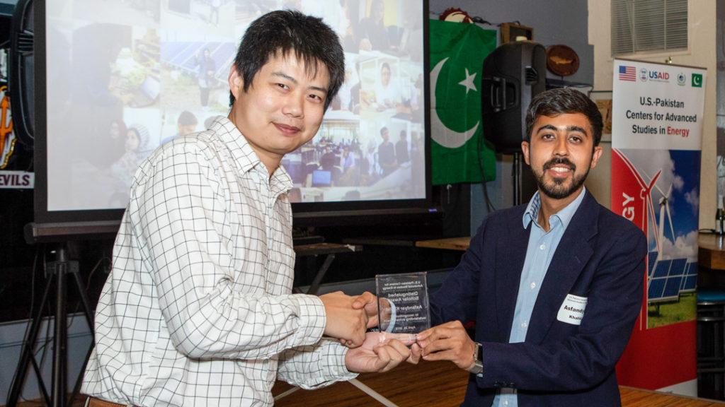 USPCAS-E scholar Asfandyar Khalid receives outstanding scholar award from Dr. Yang Weng